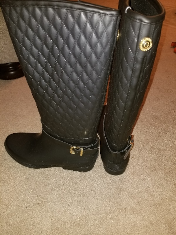 black and gray leather knee-high boots