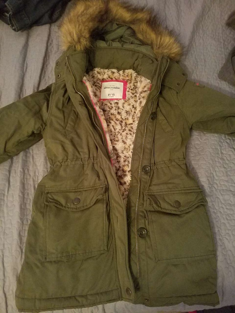 green buttons up zip-up jacket