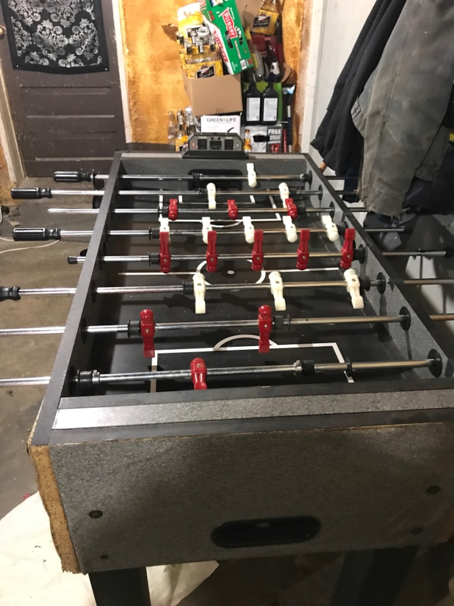 black, white, and red foosball table