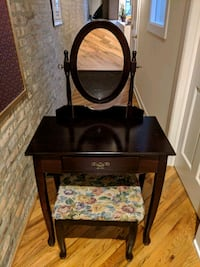 Dark brown wooden vanity table with mirror