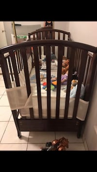 brown wooden crib frame