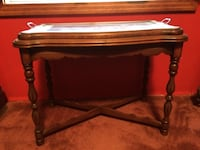 Antique tea table with removable glass top serving tray.  Mahogany or cherry wood. Corinth, 38834