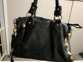 Purse, black with side gold detailing .
