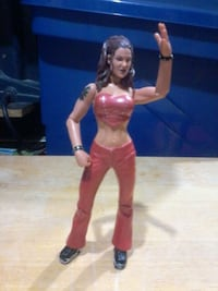 female wearing red pants and black shoes action figure New York, 10302