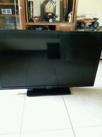 black flat screen TV with remote Jacksonville Beach, 32250