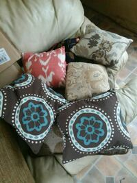 several assorted-color throw pillows 832 mi