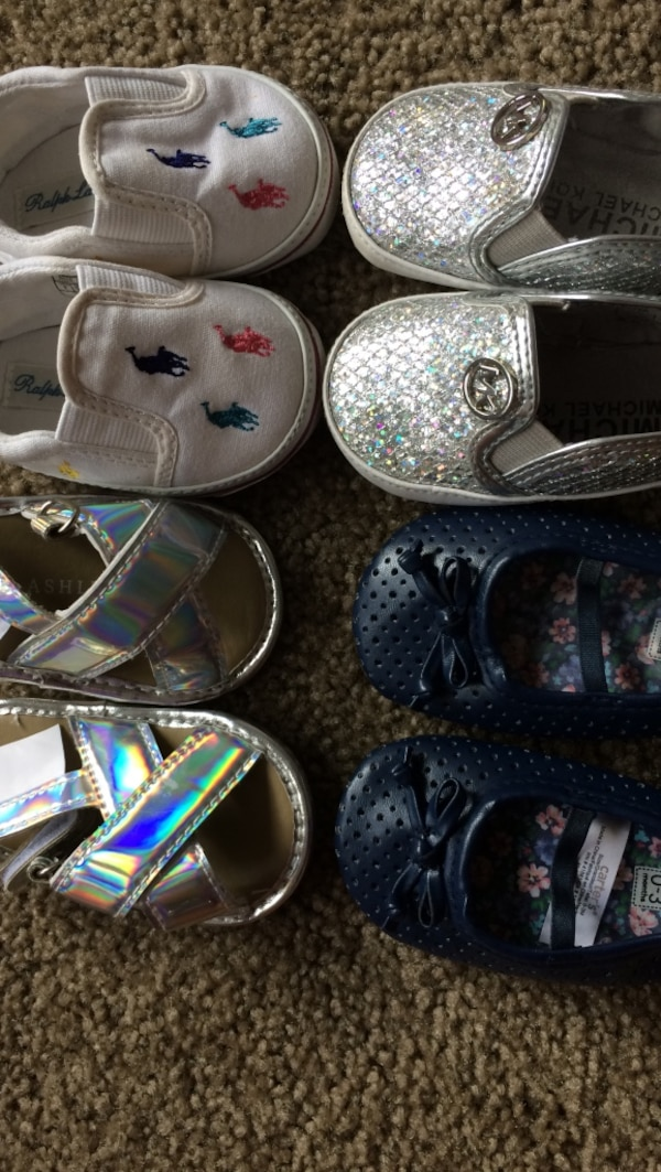 toddler's two pairs of shoes