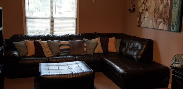 Used Tufted Brown Leather Sectional Sofa With Throw Pillows And