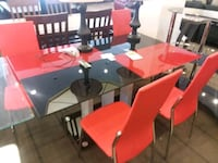 Red and black glass table w 4 chairs on sale  Phoenix, 85018