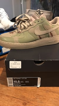pair of green-and-white camouflage nike air force 1 on box 26 mi