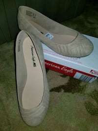 Tan slip on flat shoes