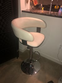 Two white leather padded bar seat