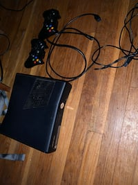 Black xbox 360 console with 2 controllers, power cord, hdmi cord, battery packs and charging cable and new set of batteries Silver Spring, 20901
