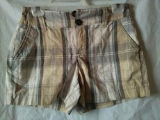 brown and white plaid shorts