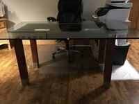 rectangular brown wooden table with black rolling chair Montréal, H3C 2P1