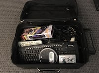 Luggage full of electronics, game accessories, and cables Bridgeport
