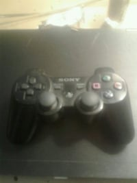 black Sony PS4 game controller Calgary, T2K
