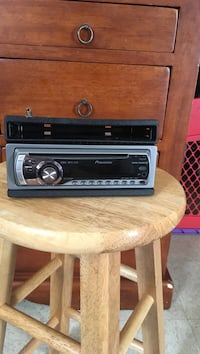 Gray and black pioneer 1-din head unit