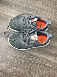 Pair of gray-and-white nike running shoes Cambridge