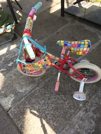 Toddler's red and yellow bike with training wheels Tiny