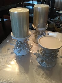 three white ceramic candle holders Ashburn