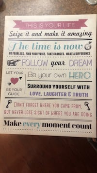 White and black wooden quote board.