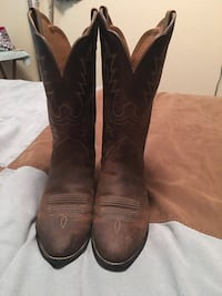 Pair of brown leather cowboy boots 879 mi