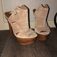 pair of brown-and-beige platform stilettos 17 mi