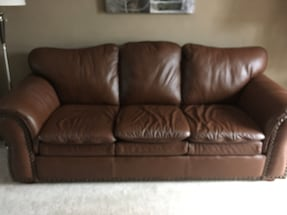 Leather couch and chair with ottoman