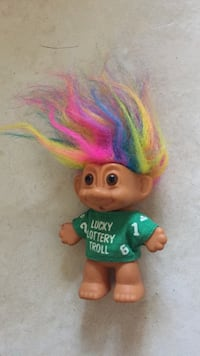 troll doll with green shirt