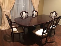 Dining room table w/leaf & 6 chairs. Price negotiable
