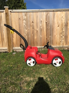 Toddler's red and black push ride on toy