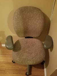 brown suede office rolling armchair