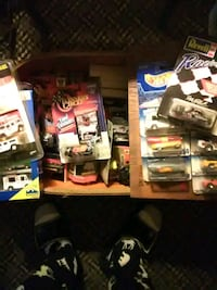 Box full of match box cars and trucks, all in the  Connellsville