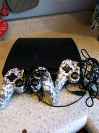 black Sony PS3 slim console with controller Washington, 20011