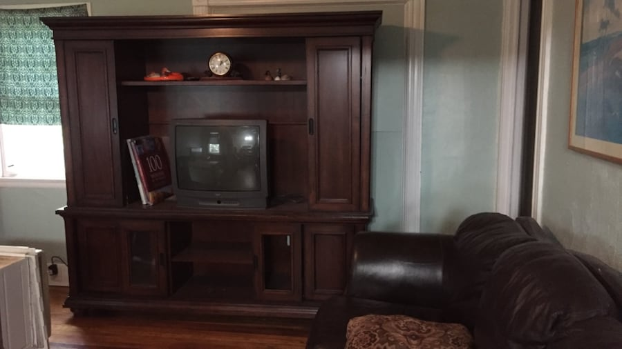 Entertainment Center With Closing Doors