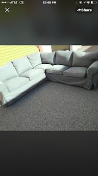 Blue grey sectional . Veryyyy comfy and easy to take apart and wash .