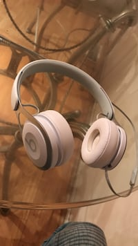 white Beats by Dr. Dre corded headphones
