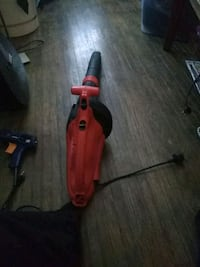 red and black electric  leaf blower