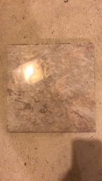 brown and white marble surface 8 mi