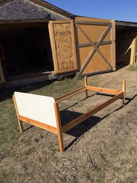 two brown wooden folding tables