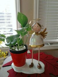 Green plant with Angel figure 543 km