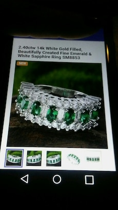 silver and green fine emerald and white sapphire ring
