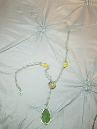 silver-colored necklace