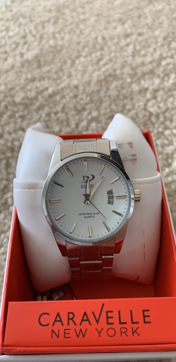 round silver Rolex analog watch with link bracelet