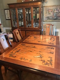 """Table 66""""x43"""". Has two additional leaves that make the table 102 inches long. Set comes with six chairs and breakfront included. Oriental themed."""