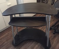 round black wooden base glass top table