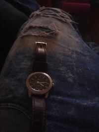 round silver chronograph watch with brown leather strap Mississauga, L5A 2J3