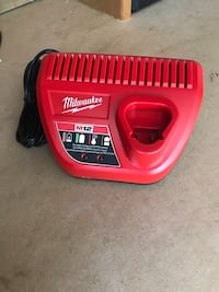 Red and black milwaukee battery charger 549 km