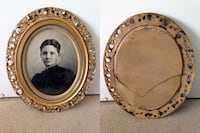 Antique gold oval framed with glass picture.  Calgary